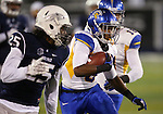 San Jose State's Thomas Tucker runs against Nevada in an NCAA college football game in Reno, Nev., on Saturday, Nov. 16, 2013. (AP Photo/Cathleen Allison)