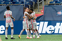 FOXBOROUGH, MA - AUGUST 29: Omir Fernandez #21 of New York Red Bulls celebrates his goal with teammates during a game between New York Red Bulls and New England Revolution at Gillette Stadium on August 29, 2020 in Foxborough, Massachusetts.