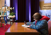 A woman signs a book of condolences during a memorial service for Lise Payette at City Hall in Montreal, Saturday, October 20, 2018. THE CANADIAN PRESS/Graham Hughes