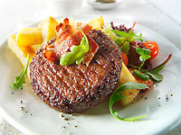 Char grilled beef burger and bacon  with chunky chips and salad photo. Funky Stock Photos