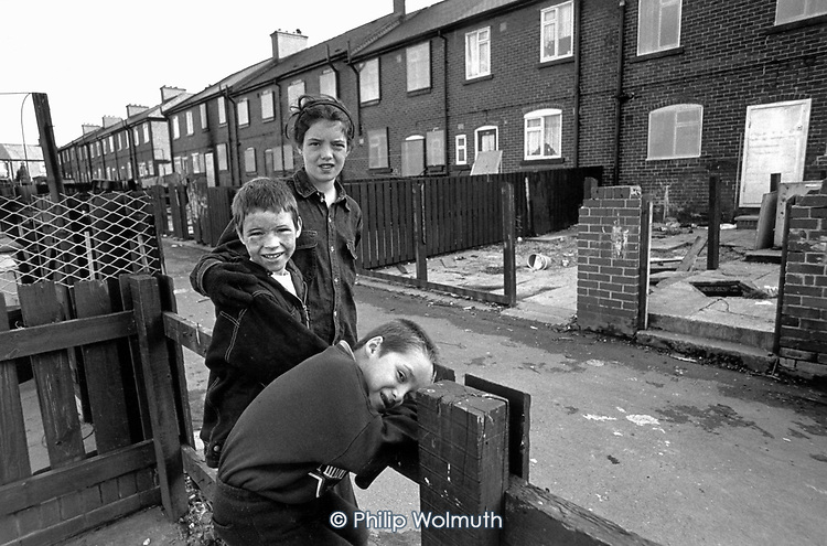 Children smash a fence for bonfire wood in a street of vandalised houses in the former pit village of Grimethorpe, South Yorkshire, which has undergone serious decline since its colliery closed in 1993, and where many ex-miners' houses are empty.