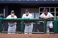 NW Arkansas Naturals coaches Brandon Moore, Jim Brower and Vance Wilson (L-R) during a game against the San Antonio Missions on May 31, 2015 at Arvest Ballpark in Springdale, Arkansas.  NW Arkansas defeated San Antonio 3-1.  (Mike Janes/Four Seam Images)