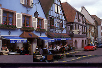 AJ1652, Alsace, outdoor cafe, France, Kaysersberg, Europe, People sitting at an outdoor cafe in the picturesque village of Kaysersberg with its half-timbered houses that line the narrow cobbled streets, a wine growing village of Alsace, France.