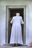 "Pope Benedict XVI is the Church closed during a visit to ""Our Lady of Health"" in Domegge, Lorenzago di Cadore, northern Italy July 23.2007"