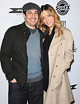 Jason Biggs and Jenny Mollen at The IFC Midnight L.A. Premiere of SUPER held at The Egyptian Theatre in Hollywood, California on March 21,2011                                                                               © 2010 Hollywood Press Agency