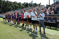CARY, NC - SEPTEMBER 12: Head coach Paul Riley of the North Carolina Courage stands in front of the bench with assistant coaches Scott Vallow, Sean Nahas, Nathan Thackeray, and the substitutes and staff before a game between Portland Thorns FC and North Carolina Courage at Sahlen's Stadium at WakeMed Soccer Park on September 12, 2021 in Cary, North Carolina.