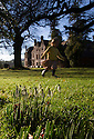 18/01/15<br /> <br /> Surrounded by sunshine and blue skies Belle Addis (2), looks for the first snowdrops of the year and other signs of spring in the grounds of Huntsham Court, a baronial private-hire house, near Tiverton,  Devon.<br /> <br /> All Rights Reserved - F Stop Press.  www.fstoppress.com. Tel: +44 (0)1335 300098