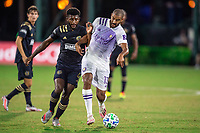 LAKE BUENA VISTA, FL - JULY 20: Tesho Akindele #13 of Orlando City SC dribbles the ball during a game between Orlando City SC and Philadelphia Union at Wide World of Sports on July 20, 2020 in Lake Buena Vista, Florida.