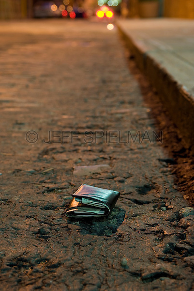 AVAILABLE FROM CORBIS FOR COMMERCIAL AND EDITORIAL LICENSING. Please go to www.corbis.com and search for image # 42-23567266.<br /> <br /> Lost Wallet on an Empty Street in Brooklyn, New York City, New York State, USA