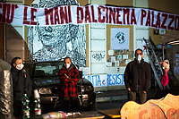 """(From L to R) Valerio Aprea (Actor), Lorenzo and Valerio Mastandrea (Director and Actor).   <br /> <br /> Rome, 03/12/2020. Today, the Nuovo Cinema Palazzo Community held a second public assembly (1.) in Rome's San Lorenzo district to protest against the eviction of the """"Nuovo Cinema Palazzo"""" completed by the Italian police forces in the early morning of the 25th of November and to demonstrate against the violent reaction of the Police forces when, in the evening of the same day, a large demo asked to have the chance to hold a public assembly in the square (Piazza dei Sanniti) of the cinema (2.). The public assembly of today saw the participation and the support & solidarity of the representatives of movements, actors, musicians, students, artists, politicians, and citizens of San Lorenzo who told their stories and memories related to the famous Rome's Art and culture occupation (For example, actor Marcello Fonte, Best Actor Award of the 2018 Cannes Film Festival for the film Dogman, was among the first group of occupiers of the Nuovo Cinema Palazzo). The assembly of the 1st December was interrupted due to the bad weather (3).<br /> The Nuovo Cinema Palazzo was occupied the 15th of April 2011, when citizens, movements, workers of the entertainment industry reopened the former """"Palazzo Cinema"""" to prevent the opening of a casino/gambling space. The illegal occupation was intended as a public hub of art, culture, sport and politics, an open place for exchange, discussion, studies, caring and sharing.<br /> <br /> Footnotes & Links:<br /> 1. http://bit.do/fLCpE<br /> 2. Demo And Clashes Against Nuovo Cinema Palazzo Eviction in Rome's San Lorenzo: http://bit.do/fLxgz<br /> 3. http://bit.do/fLCr3<br /> Previous Stories about Nuovo Cinema Palazzo: 14.04.2018 - Nuovo Cinema Palazzo's Concert: """"7 Anni di CasiNò 