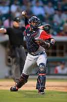 Gwinnett Braves catcher Christian Bethancourt (38) makes a throw to first base against the Charlotte Knights at BB&T BallPark on August 11, 2015 in Charlotte, North Carolina.  The Knights defeated the Braves 3-2.  (Brian Westerholt/Four Seam Images)