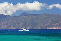 A charter boat and snorkeler at Kapalua, Maui, with Moloka'i in the background.