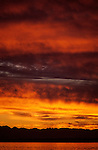 Stratocumulus clouds dramatic sunset over Puget Sound and Olympic Mountain Range stratocumulus clouds Seattle Washington State USA..