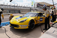 Engineers checking tire pressure of Rick Taylor Jordan Taylor / Tom Milner of Corvette Racing (65) LMGTE Corvette C7.R in the pit road FIA World Endurance Challenge, Thursday, September 18, 2014 in Austin, Tex. (Gary Faulkenberry/TFV Media via AP Images)