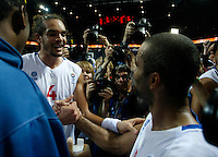 French national basketball team players celebrate victory with their fans and supporters after semifinal basketball game between France and Russia in Kaunas, Lithuania, Eurobasket 2011, Friday, September 16, 2011. (photo: Pedja Milosavljevic)