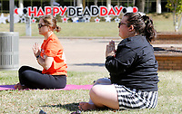 Mackenzie Payton (right), a senior residential assistant, and Thalita Da Silva Hotz, a graduate assistant, listen to yoga teacher Philip Shepherd, with the Department of University Recreation, Friday, April 30, 2021, as they participate in a stretching yoga session during the Dead Day Bash on the campus of the University of Arkansas in Fayetteville. Hosted by University Housing the event include lawn games, a hot dog grill out, a study tips scavenger hunt and other activities. Check out nwaonline.com/210501Daily/ and nwadg.com/photos for a photo gallery.<br /> (NWA Democrat-Gazette/David Gottschalk)