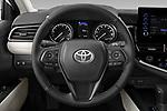 Car pictures of steering wheel view of a 2021 Toyota Camry SE 4 Door Sedan Steering Wheel