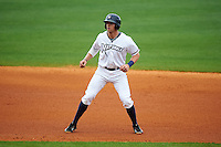 NW Arkansas third baseman Hunter Dozier (9) leads off second during a game against the San Antonio Missions on May 31, 2015 at Arvest Ballpark in Springdale, Arkansas.  NW Arkansas defeated San Antonio 3-1.  (Mike Janes/Four Seam Images)