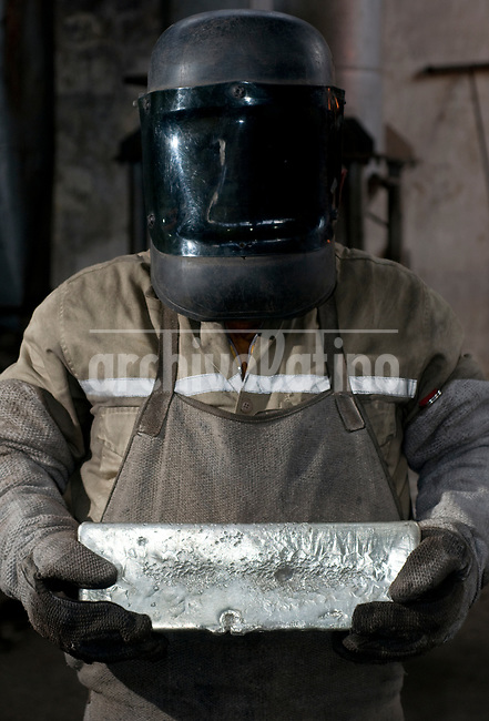 A just melt raw gold bar at the furnaceof  Maria Dama, Antioquia department, Colombia. This is the first step to get pure gold, successive melting and chemical process are necessary to get the refined product