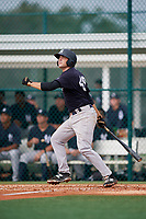 GCL Yankees East catcher Alex Guerrero (49) follows through on a swing during the first game of a doubleheader against the GCL Pirates on July 31, 2018 at Pirate City Complex in Bradenton, Florida.  GCL Yankees East defeated GCL Pirates 2-0.  (Mike Janes/Four Seam Images)