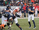 November 17, Quarterback Ian Brook prepares to pass during the Shamrock Series football game against Syracuse in Yankee Stadium, New York. (Photo by Barbara Johnston/University of Notre Dame)