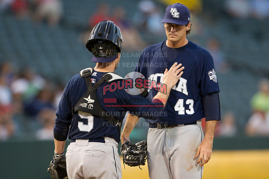 New Orleans Zephyrs starting pitcher Brian Flynn (43) talks with catcher Koyie Hill (5) on the mound against the Memphis Redbirds in the Pacific Coast League baseball game on June 12, 2013 at Autozone Park in Memphis, Tennessee. Memphis defeated New Orleans 9-3. (Andrew Woolley/Four Seam Images)