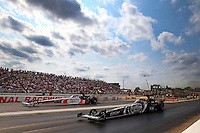 Aug. 18, 2013; Brainerd, MN, USA: NHRA top fuel dragster driver Shawn Langdon (near lane) races alongside Clay Millican during the Lucas Oil Nationals at Brainerd International Raceway. Mandatory Credit: Mark J. Rebilas-