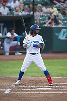 Ogden Raptors shortstop Ronny Brito (5) at bat during a Pioneer League game against the Great Falls Voyagers at Lindquist Field on August 23, 2018 in Ogden, Utah. The Ogden Raptors defeated the Great Falls Voyagers by a score of 8-7. (Zachary Lucy/Four Seam Images)