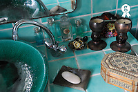 Soap and jewels beside washbasin and faucet (Licence this image exclusively with Getty: http://www.gettyimages.com/detail/92866139 )