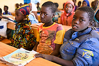 BURKINA FASO, Kaya, children of IDP internal displaced persons, inland refugees, in a catholic school after terrorist attack in their village Dablo / BURKINA FASO, Kaya, Schule der Diozöse Kaya fuer Kinder von IDP Fluechtlingen aus von Islamisten attackierten Doerfern, Junge Barnabé aus überfallenem Dorf Dablo
