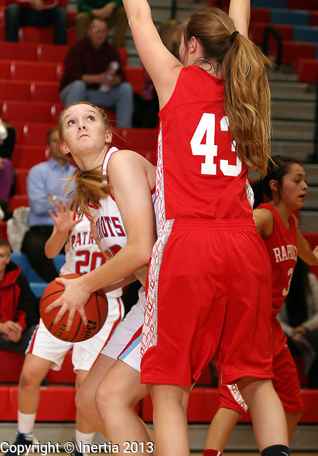 SIOUX FALLS, SD: DECEMBER 13: Jill Ricke #50 from Lincoln looks to the basket past Grace Weeks #43 from Rapid City Central in the first half of their game Friday night at Lincoln High. (photo by Dave Eggen/Inertia)