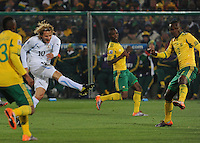 Midfielder Diego Forlan unleashes his 24th minute shot, which would give Uruguay a 1-0 lead into halftime. Uruguay defeated South Africa, 2-0, in both teams' second match of play in Group A of the 2010 FIFA World Cup. The match was played at Loftus Versfeld in Pretoria, South Africa June 16th.