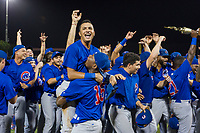 Yonathan Perlaza (15) lifts Jose Gutierrez (91) as the 2017 Arizona League Champions AZL Cubs celebrate after defeating the AZL Giants on September 7, 2017 at Scottsdale Stadium in Scottsdale, Arizona. AZL Cubs defeated the AZL Giants 13-3 to win the Arizona League Championship Series two games to one. (Zachary Lucy/Four Seam Images)