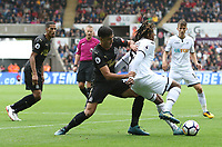 Renato Sanches of Swansea City is challenged by Ciaran Clark of Newcastle United  during the Premier League match between Swansea City and Newcastle United at The Liberty Stadium, Swansea, Wales, UK. Sunday 10 September 2017