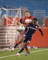 FC Dallas midfielder Dave van den Bergh (7) challenges New England Revolution forward/midfielder Kenny Mansally (29). The New England Revolution defeated FC Dallas, 2-1, at Gillette Stadium on April 4, 2009. Photo by Andrew Katsampes /isiphotos.com