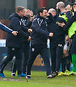 The Dundee dug out celebrate after David Clarkson scores their late winning goal.