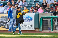A fan participates in ballon batting between innings during the game between the Iowa Cubs and the Salt Lake Bees in Pacific Coast League action at Smith's Ballpark on May 13, 2017 in Salt Lake City, Utah. Salt Lake defeated Iowa  5-4. (Stephen Smith/Four Seam Images)