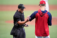 Umpire Ray Valero works a game between the Greensboro Grasshoppers and the Greenville Drive on Thursday, July 22, 2021, at Fluor Field at the West End in Greenville, South Carolina. (Tom Priddy/Four Seam Images)