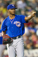 Iowa Cubs pitcher Alberto Cabrera (22) point to a teammate in the Pacific Coast League baseball game against the Round Rock Express on July 21, 2013 at the Dell Diamond in Round Rock, Texas. Round Rock defeated Iowa 3-0. (Andrew Woolley/Four Seam Images)