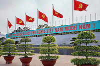 """Vietnam. Hanoi. Outside Ho Chi Minh's Mausoleum float in the air six flags of the Vietnamese Communist Party. Alphabet and writings in vietnamese language say:  """" Long life to the Communist Party. Ho Chí Minh (May 19, 1890 - September 2, 1969) was a Vietnamese Communist revolutionary, who led the Viet Minh independence movement from 1941 onward, statesman as Prime Minister (1946-1955) and President (1946-1969) of the Democratic Republic of Vietnam (North Vietnam). 04.04.09 © 2009 Didier Ruef"""