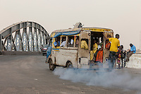 Senegal, Saint Louis.   Local Bus Heading on to the Pont Faidherbe, Bridge over the River Senegal.  Built 1897.
