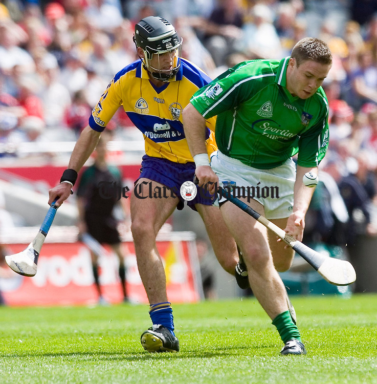 Clare's Brendan Bugler moves in on Limerick's Michael Fitzgerald. Photograph by John Kelly.