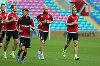 CARDIFF, WALES - SEPTEMBER 05: Gareth Bale (R) and team mate James Collins (C) warm up during the Wales training session, ahead of the UEFA Euro 2016 qualifier against Israel, at the Cardiff City Stadium on September 5, 2015 in Cardiff, Wales.