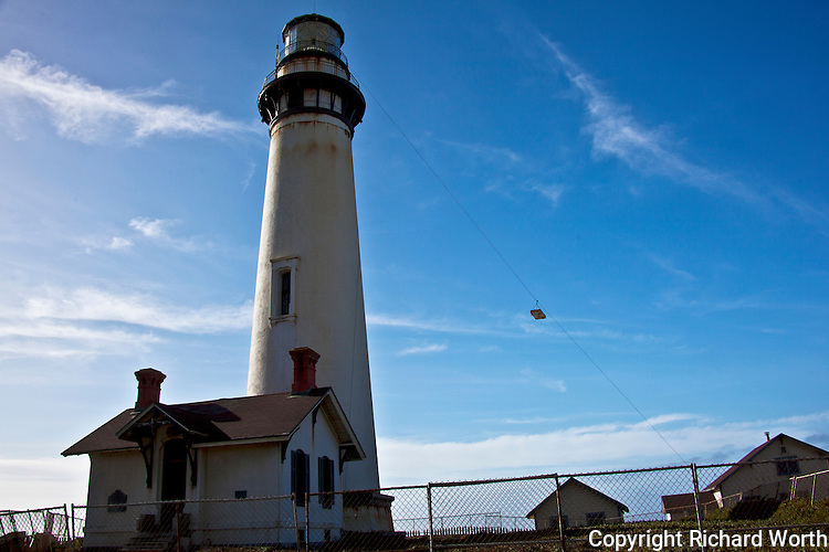 Sections of the Pigeon Point Fresnel lens are suspended in midair on a zipline, headed to the ground during restoration of the historic light station.