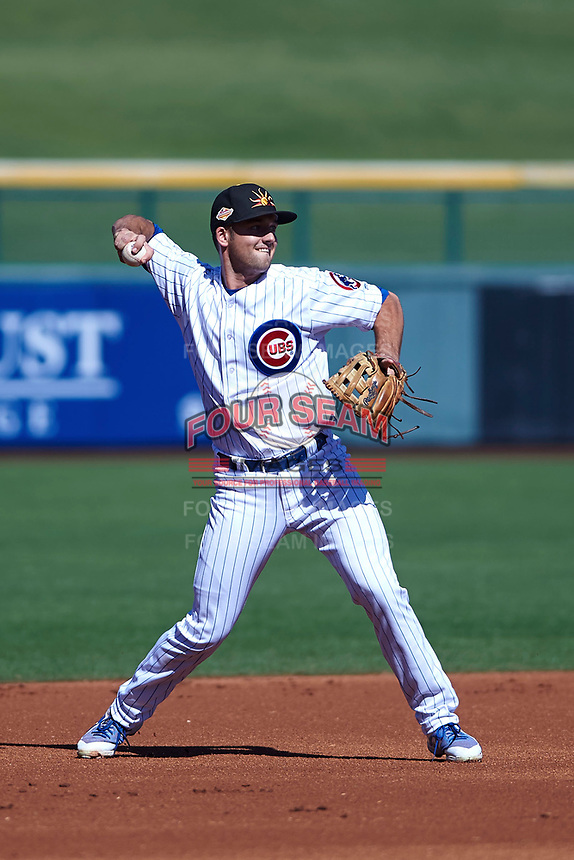 Mesa Solar Sox third baseman Jason Vosler (22), of the Chicago Cubs organization, makes a throw to first base during an Arizona Fall League game against the Peoria Javelinas on October 25, 2017 at Sloan Park in Mesa, Arizona. The Solar Sox defeated the Javelinas 6-3. (Zachary Lucy/Four Seam Images)