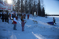 Jeremiah Klejka crosses the finish line of the 2011 Jr. Iditarod   to place first.  Willow, Alaska