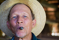 Portrait of a mature tobacco farmer smoking a cigar, Vinales, Pinar del Rio Province, Cuba.