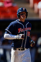 Matt Chapman #19 of the Cal State Fullerton Titans runs to first base against the Texas A&M Aggies at Goodwin Field on March 10, 2013 in Fullerton, California. (Larry Goren/Four Seam Images)