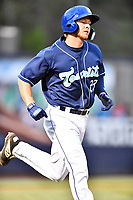 Asheville Tourists designated hitter Willie MacIver (23) runs to first base during a game against the West Virginia Power at McCormick Field on April 18, 2019 in Asheville, North Carolina. The Power defeated the Tourists 12-7. (Tony Farlow/Four Seam Images)