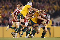 MELBOURNE, 29 JUNE 2013 - Jonathan DAVIES of the Lions is tackled by Wycliff PALU of the Wallabies during the Second Test match between the Australian Wallabies and the British & Irish Lions at Etihad Stadium on 29 June 2013 in Melbourne, Australia. (Photo Sydney Low / sydlow.com)